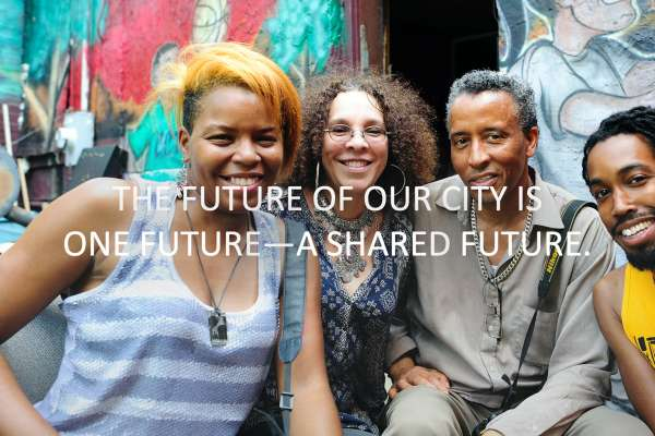 Image text: The future of our city is one future — a shared future. Shows a multiethnic group in front of a mural.