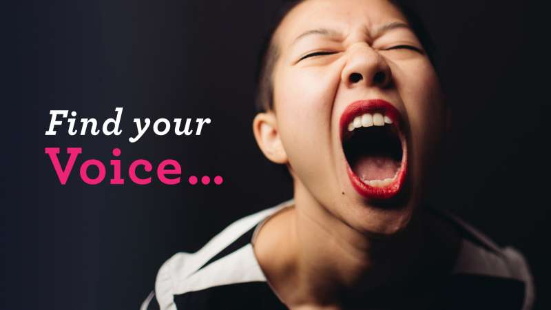 A young Asian woman defiantly shouting toward the camera. Image text: Find your voice.