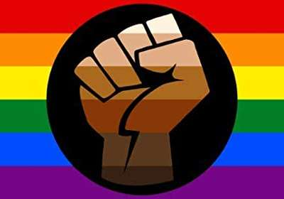 Image of a Pride flag with BLM fist in the center.